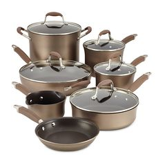 This 11 piece cookware set features graceful tulip-shaped designs and heavy duty hard anodized construction for exceptional heat distribution. From Anolon Cookware, this nonstick large cookware set includes light brown pots and pans with rich bronze-color Cast Iron Cookware, Cookware Set, Pots And Pans Sets, Pan Set, Kitchen Utensils, Kitchen Tools, Kitchen Stuff, Kitchen Dining, Kitchen Ideas