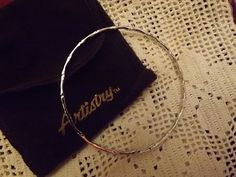 Very+elegant+but+simple+silvertone+bangle+bracelet+with+a+bamboo+pattern,+2+and+3/4+inches+in+diameter.+This+item+is+NEW,+vintage+and+is+packaged+in+the+original+felt+bag+and+box.+