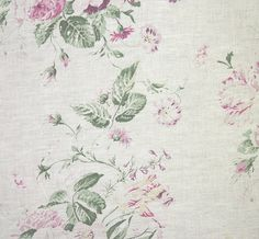 Constance Linen Fabric A beautiful linen fabric with a faded floral design printed in purple, green, pink and yellow.