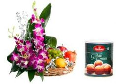 Exclusive fresh seasonal fruits 1000 gms. (grape, apple, pomegranate, orange etc.) combination with orchid arrangement and 1 kg. haldiram gulabjamun tin box- Send this exclusive gift to your loved ones through us.