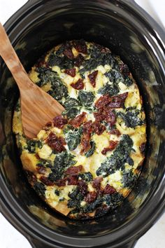 With just 15 minutes of prep, this slow cooker spinach feta egg casserole couldn't be easier! Perfect for a holiday brunch OR a make-ahead breakfast!