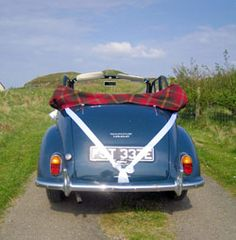 Our Morris Minor is navy blue with a red vinyl roof. It is driven by a friendly chauffeur, so you are guaranteed a little 1960s style glamour, and the Morris cars seem to make everybody smile!