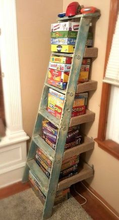 11 Surprising Ways To Reuse Your Household Clutter - this is a great way to get . 11 Surprising Ways To Reuse Your Household Clutter – this is a great way to get the games out of Ladder Shelf Diy, Old Ladder, Ladder Storage, Wooden Ladder, Vintage Ladder, Stair Storage, Storage Room, Ladder Decor, Board Game Storage