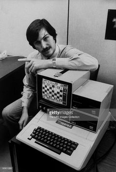 Apple Computer co-founder Steve Jobs w. Apple II computer, w. chess game displayed on screen.
