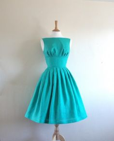 I'm pinning it again, but seriously, I'm in love. Ugh, I wish it was cheaper...and it looks closer to the right blue.  I'm in love with this turqoise 50s style bridesmaid dress!!!!!!!!!! @Lauren Ellis