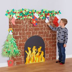 Create a cosy Christmas fireplace amp; hearth : Christmas Fireplace and Hearth Office Christmas Decorations, Christmas Window Display, Cosy Christmas, Christmas Fireplace, Christmas Grotto Ideas, Green Christmas, Preschool Christmas, Christmas Activities, Christmas Crafts For Kids