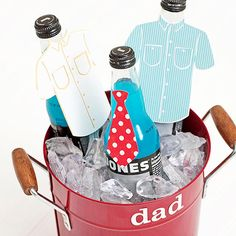"Love this idea for a Father's Day gift...a cutom drink bucket for Dad complete with cute shirt and tie cut outs.  You could personalize the bottle ""outfit"" to what your Dad wears."