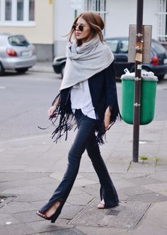 Loosely wrap a blanket scarf around your neck. The volume adds interest (& warmth) to your fall look.