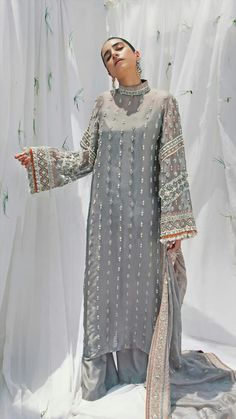 Includes :Shirt: : OrganzaPants : Raw silkDupatta : OrganzaProduct Description:When the cloudy grey meets chic rust, the old classic is born. the garment consists of a grey organza shirt with pearl sp Desi Wedding Dresses, Pakistani Formal Dresses, Shadi Dresses, Pakistani Wedding Outfits, Pakistani Dress Design, Party Wear Dresses, Indian Dresses, Indian Outfits, Punjabi Wedding