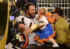 . Evan Mathis (69) of the Denver Broncos celebrates with his daughter, Aven, after the game. The Denver Broncos played the Carolina Panthers in Super Bowl 50 at Levi\'s Stadium in Santa Clara, Calif. on February 7, 2016. (Photo by AAron Ontiveroz/The Denver Post)