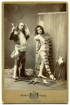 Antique cabinet photo from Gustavo Arcaris and Kate, knife-throwing act.