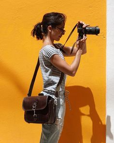 Loving this shot of @stephne_p with her Sony a7R III attached to our Westminster strap and all kept nice and secure in our Regent Street bag. The world's first camera bag made entirely of Horween Chromexcel leather.
