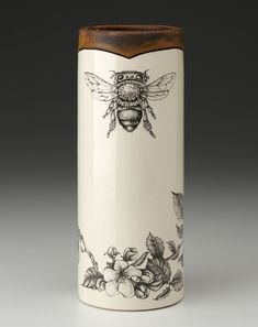 A delightful honey bee graces the face of this Laura Zindel Design Honey Bee Small Vase. Handcrafted from ceramic earthenware, this beautiful vase has an organic, natural feel and features a honey bee with cheerful floral accents. 3d Laser Printer, I Love Bees, Bee Gifts, Bee Art, Bee Happy, Bees Knees, Queen Bees, Pottery Art, Ceramic Pottery