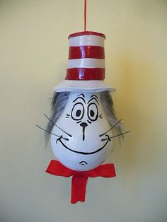 Cat In The Hat ~ lightbulb ornament ~ oven-baked clay, paint, ribbon, whiskers, & furry fabric. by CAyers Painted Ornaments, Diy Christmas Ornaments, Christmas Projects, Holiday Crafts, Lightbulb Ornaments, Lightbulbs, Christmas Light Bulbs, Simple Christmas, Light Bulb Crafts