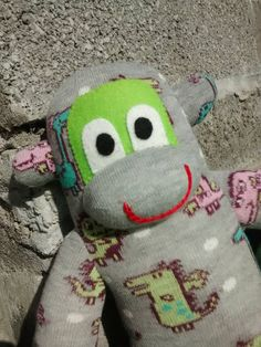 Check out this item in my Etsy shop https://www.etsy.com/uk/listing/249736135/sock-monkey-with-monsters