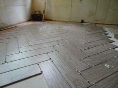 (via Danny Seo) Shaw Floors (ceramic tile that looks like petrified wood) laid in herringbone... made in the USA and eco friendly.