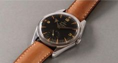 Omega A fine and attractive stainless steel wristwatch with black dial and subsidiary seconds | Classic Driver Market