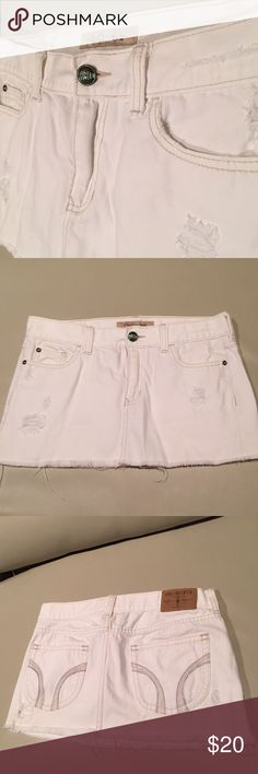 "Hollister Distressed Mini Skirt Standard 5 Pockets  Front Zipper & Button Closure   100% Cotton  Color: White  Size: 9  Mini low rise  Front Length: Approx 11"" Back Length: Approx 12"" Amazing Condition. Worn only once or twice. [ jean skirt * denim skirt * mini skirt * white skirt * distressed * holes ] Hollister Skirts Mini"