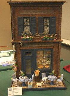1:12 scale shop front of a French bakery with tables and chairs outside built by Betty Bonney