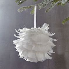 Feather Ball ornament from West Elm. This would be simple to make with a foam ball, some pretty ribbon, feathers and a hot glue gun...