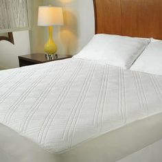 """Add extra comfort to your bed with this quilted memory foam mattress pad.  Product: King memory foam matress padConstruction Material: Polyurethane and polypropyleneColor: WhiteFeatures:  100% HypoallergenicTop layer of memory foam adds comfort to your mattress and offers pressure reliving supportExtraordinary therapeutic pressure relieving material that gently molds to the shape of the body Integrated fitted skirt which accommodates mattresses up to 15-18""""deep and will help hold your…"""