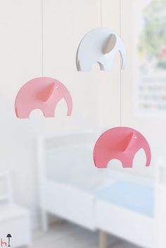 Three cute 3D elephants by Flensted Mobiles will rock your little one to a sweet sleep.