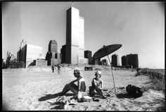 The twin towers of the World Trade Center are seen in the distance as locals visit the beach formed on what was once the Battery Park landfill in New York in July, 1983. Photo by Marilynn K. Yee/The New York Times