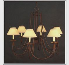 """9044-35  SIX LIGHT IRON CHANDELIER FINISH SHOWN: NATURAL RUST SHADE: 3X7X5 WITH WHITE PAPER CANDLE MAXIMUM WATTAGE: 360 CANDELABRA BASE SOCKETS  HT 29"""" W 35"""""""