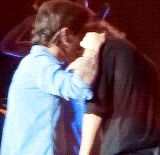 I wonder what Zayn is whispering in his ear