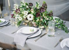 White and purple, garden-inspired centerpiece.