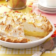 Favorite Coconut Meringue Pie Recipe -We usually have a good selection of pies at our neighborhood get-togethers, but I always come home with an empty pan when I bring this classic. Friends line up for a creamy slice, topped with golden meringue and toasted coconut. -Betty Sitzman, Wray, Colorado