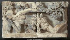 Gislebertus,sculptor.The temptation of Eve. Limestone lintel, around 1130