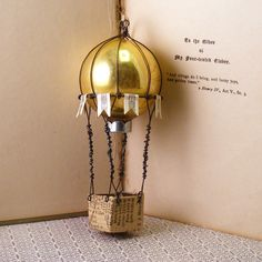 Great crafting idea, make a balloon from a vintage Christmas ornament! From Hopemore Studio: Up up and away  for Jen