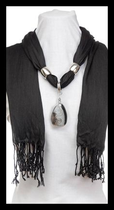 Classic look. Goes with everything! Our scarves blend fashion and jewelry all together in one package. This BLACK scarf is embellished with a Regalite pendant of complimentary colors and silver beads that can be moved around for just the right look for you.