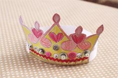 Free Printable Paper Crown Kids Craft. Print off this crown template, decorate, cut, and glue together for a fun and easy kids craft idea that encourages creative play!