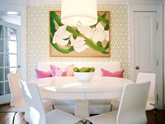 Pink and green eating space - love the bold patterned wallpaper with the pop of pink.