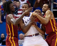 Iowa State's Jameel McKay (1) and Bryce Dejean-Jones (13) wrestle Kansas' Wayne Seldon Jr. (1) for possession of the ball on February 2, 2015 at Phog Allen Fieldhouse in Lawrence, Kan. Photo by Brian Achenbach/Special to the Tribune