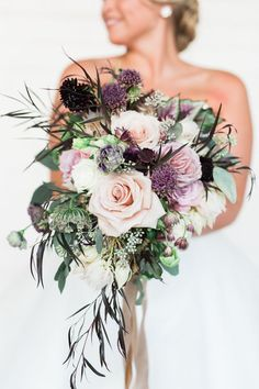 purple and pink bouquets - photo by Casto Photo http://ruffledblog.com/modern-atlanta-wedding-at-american-spirit-works