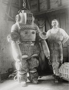 Man with robot - Correction: It's a diving suit.