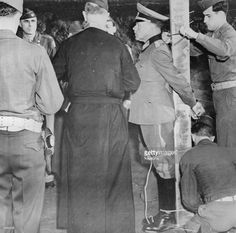 The first Nazi General to be executed, Anton Dostler, is tied to a post in Aversa to face a US Army firing squad. He was tried by an American military tribunal for the summary shooting of 15 prisoners while serving as the General Commanding the 75th German Army Corps.