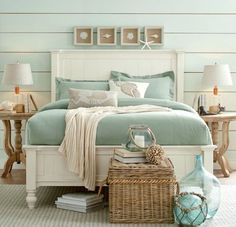 Seashell Shadow Boxes above Headboard... http://www.completely-coastal.com/2016/09/above-the-bed-wall-decor-ideas.html