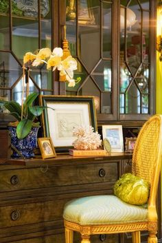 Splendid Sass: Love the secretary and styling. In the South, though, that little book on Buddha would be a Bible (just keeping it real...)