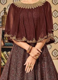 Brown Art Silk Cape Style Anarkali Suit Source by Indian Gowns Dresses, Indian Fashion Dresses, Indian Designer Outfits, Designer Dresses, Lehenga Designs, Kurti Designs Party Wear, Stylish Dress Designs, Stylish Dresses, Casual Dresses