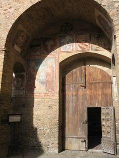 I love the little door in the big door to this church in San Gimignano, Italy.