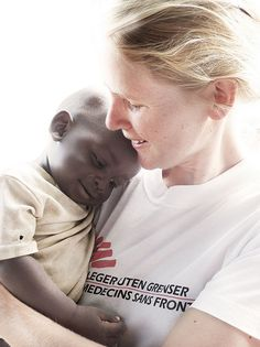 Doctors without borders a wonderful group of physicians who give of their time to help the less fortunate and disadvantaged- Here you see a doctor in Sudan with a precious child