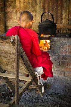 Little monk staying warm