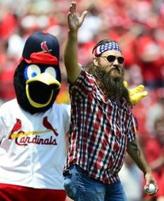 Willie Robertson of Duck Dynasty throws out a first pitch before a game against the Marlins.  7-07-13