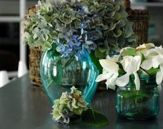 Mod Podge + food coloring + a splash of water (to thin) = vintage-look blue Mason jars