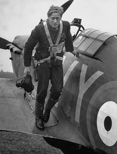 Royal Air Force ace Albert Gerald Lewis climbs out of his plane after air battle above the skies above England