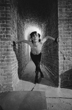 Peter Murphy from Bauhaus posed at the Roundhouse in Camden, London during the filming of the Ziggy Stardust video in August 1982.
